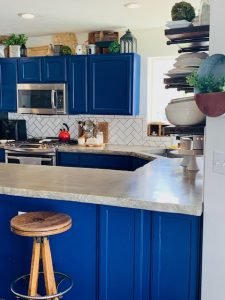 how to paint kitchen cabinets. this is a kitchen with blue cabinets